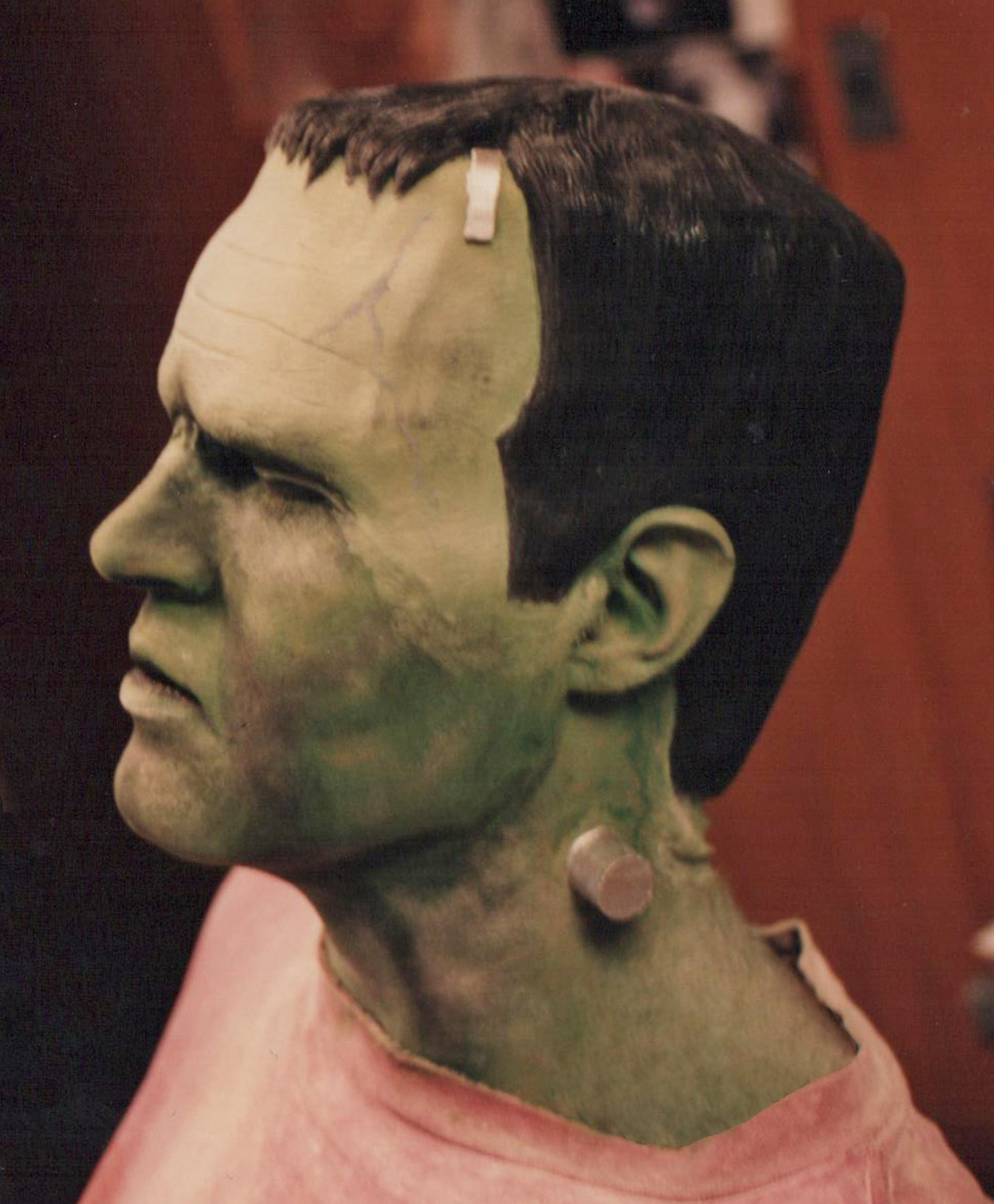 Frankenstein latex head piece applied and made up.